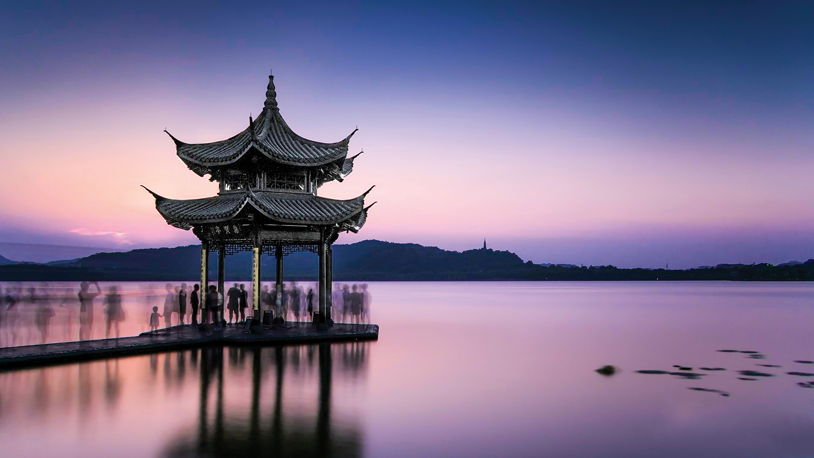 East Asian pagoda on the water at sunset
