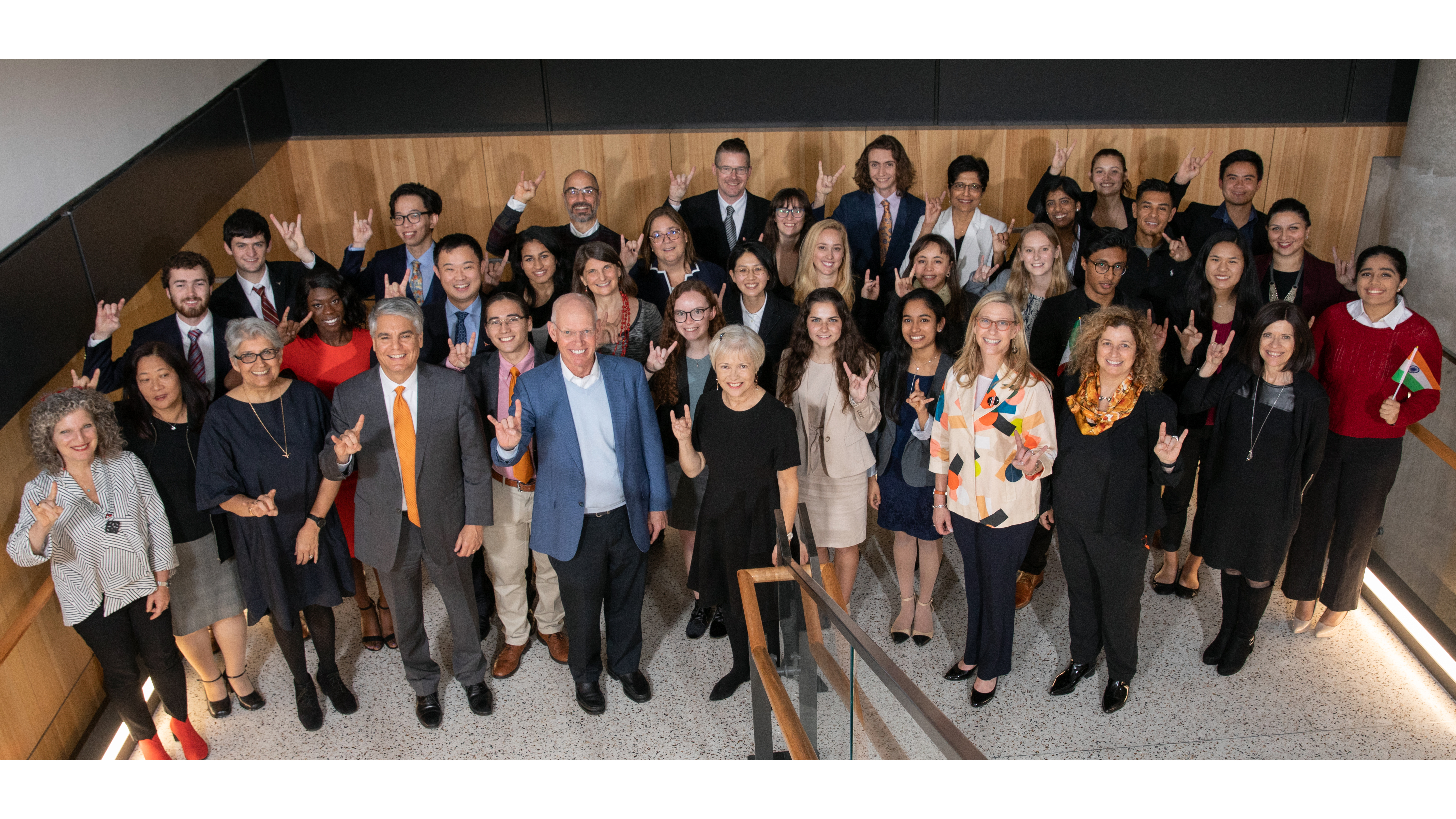 The winning teams of the president's award pose with President Fenves, Sonia Feigenbaum, and other leaders of the university