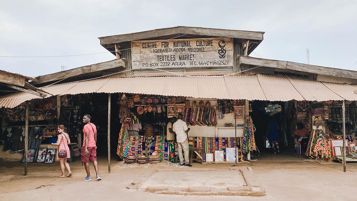 Ghanaians walk around a textile market in Ghana
