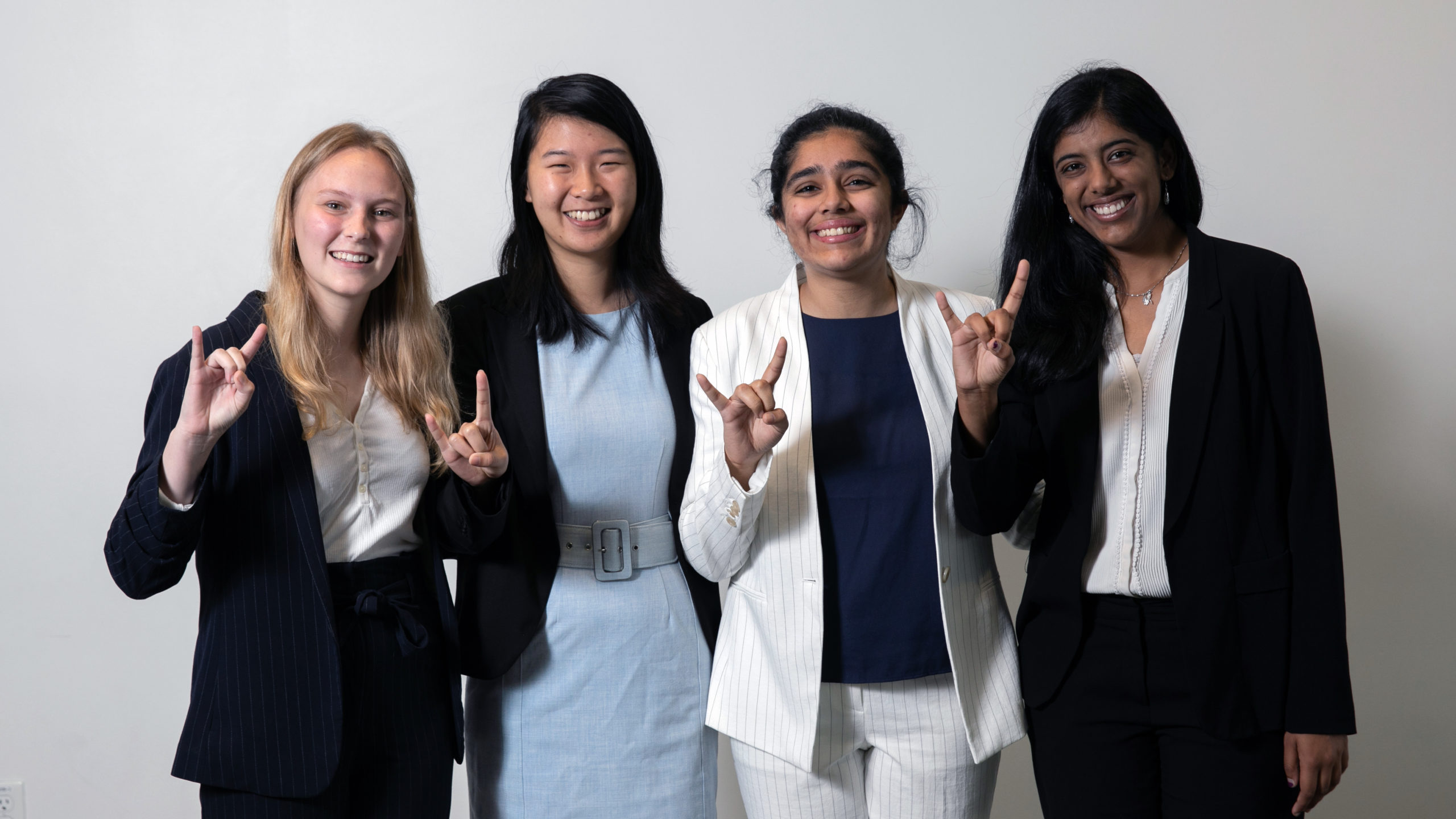 Rosaleen poses with her team after they pitched their research project