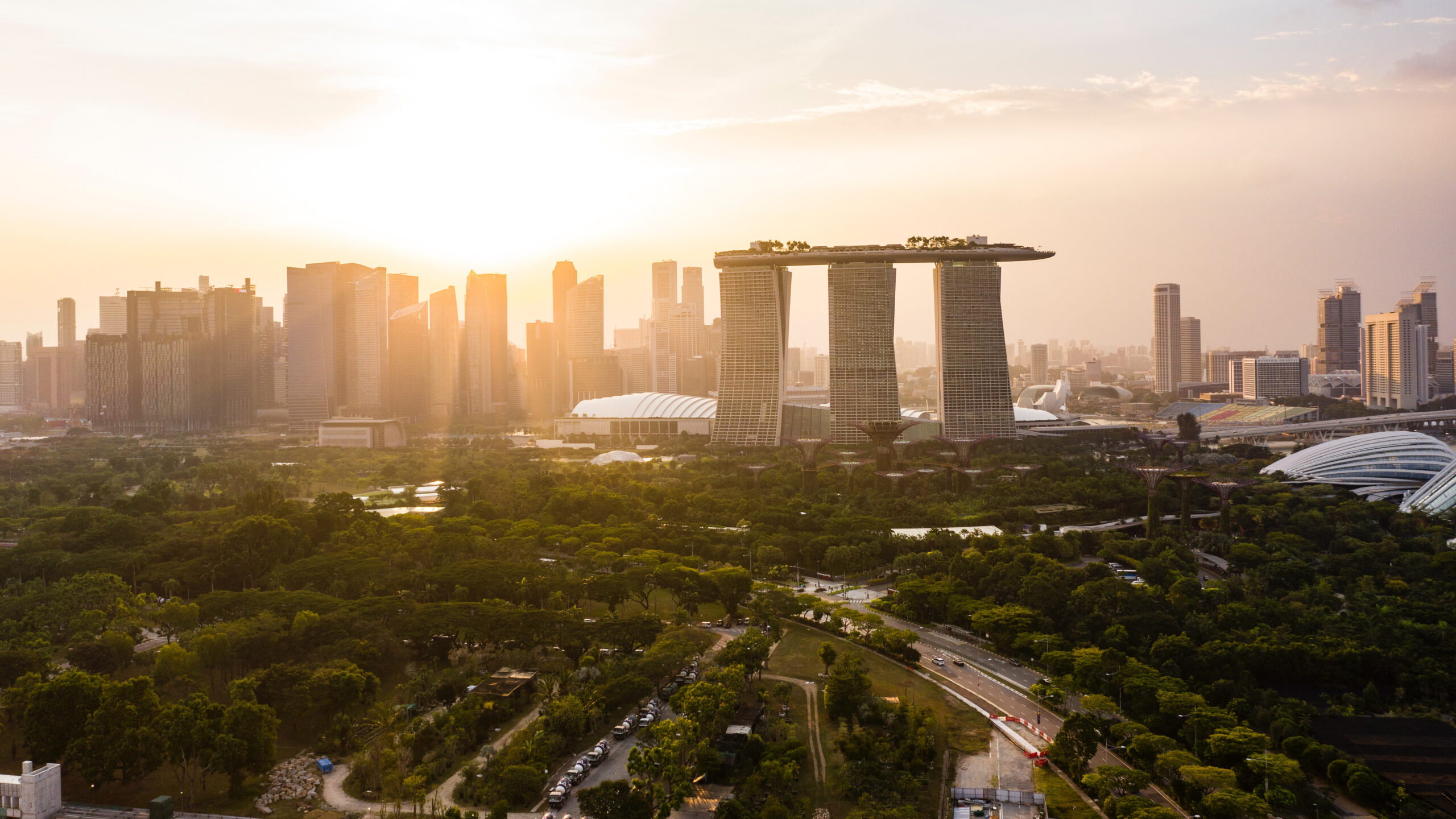 a view of singapore at sunset